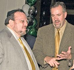 Joseph Shereshevsky (left) speaks to partner Steven Byers at an event in 2006.
