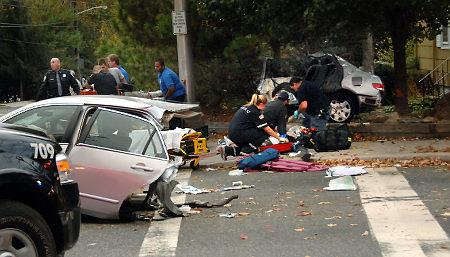 Paramedics attend to victims of the horrific car crash in New Bridge, NJ.