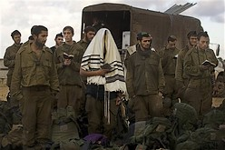 Israeli soldiers recite morning prayers after leaving the Gaza Strip into Israel Sunday, Jan. 18, 2009. [ap]