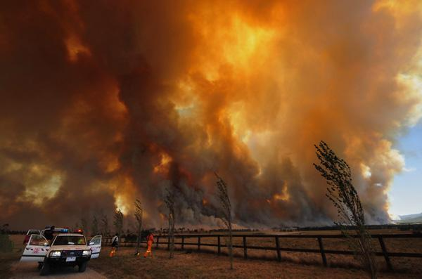 Bushfires cloud the sky.