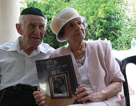 Leah and Yosef with the book  Photo: Adima Bernstein