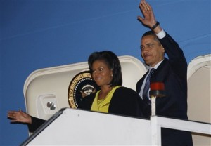 President Barack Obama and first lady Michelle Obama waves as they disembark Air Force One at London's Stansted International Airport, Tuesday, March 31, 2009. (AP Photo/Charles Dharapak)