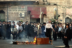 Charedim men protest and burn garbage cans as they voice their uproar for the incarceration of an ultra orthodox woman who is acused of abusing her three year old son and starving him to the point of malnutrition,  Photo by nati shohat / Flash90