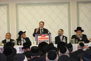 Attorney Jacob Laufer at the podium Photo Credit: Hershy Rubenstein