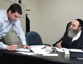 Rabbi Niederman issues instructions to his right-hand man David Katz