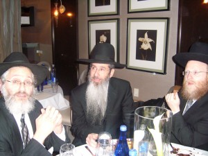 Sendy Ornstein and Rabbi Chaim Steinmetz of Renewal with Rabbi Dovid Goldwasser at the seudas hodaah.