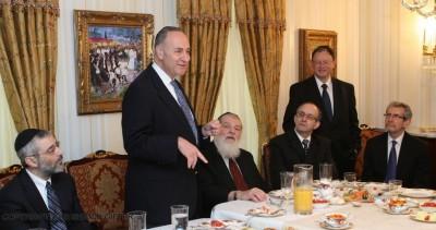 Sen. Schumer at Abe Biderman's home in Borough Park (L-R) Rabbi Chaim Dovid Zwiebel, Rabbi Nosen Sherman, [standing] Abe Biderman