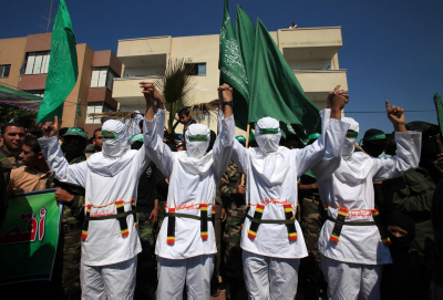 Masked Palestinian Hamas militants attend a rally in the Nusseirat refugee camp in the central of Gaza Strip on March 19, 2010 against Israel's renovation of a synagogue in Jerusalem's Old City and plans to build new settlements