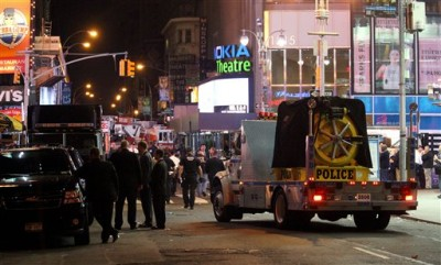 A police vehicle moves along 44th street near Times Square in New York Sunday, May 2, 2010, as an investigation was underway after an earlier incident involving a car that contained cans of gasoline, tanks of propane and fireworks. (AP Photo/Craig Ruttle)