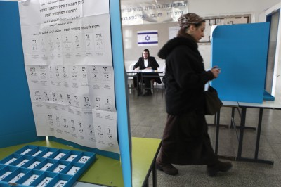 FILE - An ultra orthodox woman casts her vote at a polling station in the Beitar Illit settlement on election day. Rabbi Elyakim Levanon, chief rabbi of the Elon Moreh settlement in Samaria, has prohibited female residents from running for public office