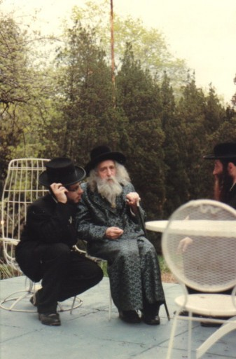 FILE - Photo taken in Monsey NY, in rebbes backyard 1982, on right side with black beard sitting the mashba'k r' Moshe Berkowitz & on the left with brown beard is mashba'k r' Avrom Hersh Glick