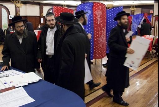 FILE Photo. Voters mingle at a polling station in Kiryas Joel, N.Y. Mark Lennihan/AP