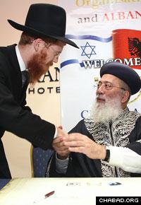 Dec. 12 2010, Israeli Chief Rabbi Shlomo Amar congratulates Albanian Chief Rabbi Yoel Kaplan. Photo: Chabad.org