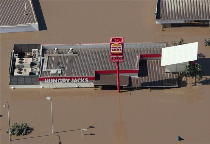 A fast food outlet is inundated by flood waters west of Brisbane January 13, 2011. REUTERS/Tim Wimborne