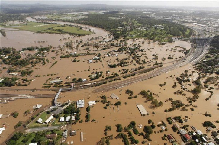 Flood water covers a section of the Ipswich motorway west of Brisbane January 13, 2011.REUTERS/Tim Wimborne