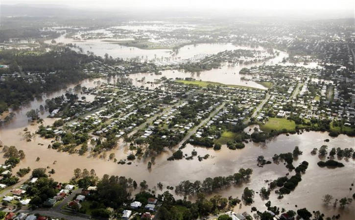The Brisbane River breaks its banks to flood residential areas west of Brisbane January 13, 2011. Flood water in Australia's third-biggest city peaked below feared catastrophic levels on Thursday but Brisbane and other devastated regions faced years of rebuilding and even the  threat of fresh floods in the weeks ahead. REUTERS/Tim Wimborne