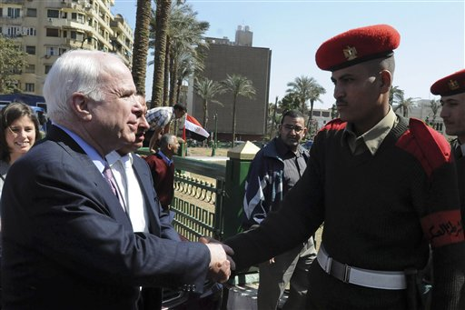 U.S. Senator John McCain, R-AZ, greets an Egyptian military police officer during his visit to Tahrir Square, the focal point of the Egyptian uprising, in Cairo, Egypt, Sunday, Feb. 27, 2011. AP