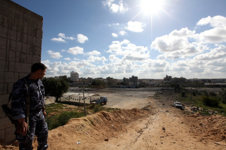 A Palestinian Hamas security stands guard at a  Hamas compound after ian air strike by Israeli war plane overnight in Beit Lahiya town in the northern Gaza Strip on, 22 March 2011. 17 Palestinians were wounded,according to  Palestinian medics  EPA/MOHAMMED SABER WAR