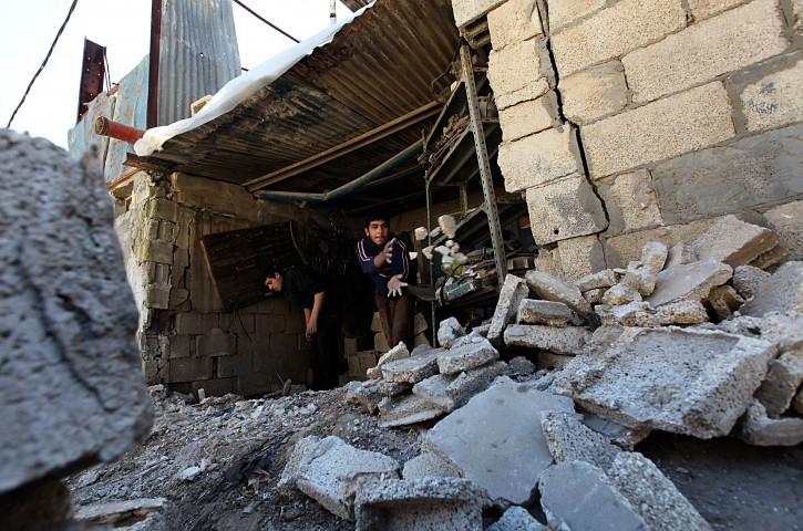 Palestinians inspect a destroyed workshop following an overnight Israeli strike  in al Zaitun area in the east of Gaza City on, 22 March 2011. According to Palestinian medics, 17 Palestinians suffered injuries.  EPA/MOHAMMED SABER WAR