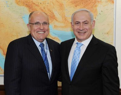 An Israeli Government Press Office (GPO) handout photograph shows Israel's Prime Minister Benjamin Netanyahu (R) posing with the former Mayor of New York City, Rudy Giuliani,  in his Jerusalem offices, in Jerusalem, Israel, 02 March 2011.  EPA/MOSHE MILNER / GOVERNMENT PRESS OFFICE / HANDOUT