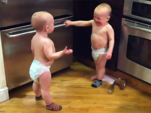 Twin brothers Sam and Ren, 18 months old, appear to be talking to each other in a video that has gone viral since it was posted to YouTube in February.