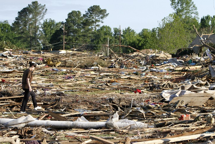 Tiffany Wood walks through her backyard looking for belongings Thursday, April 28, 2011 after a tornado hit Pleasant Grove just west of downtown Birmingham, Ala., Wednesday afternoon. (AP Photo/Butch Dill)