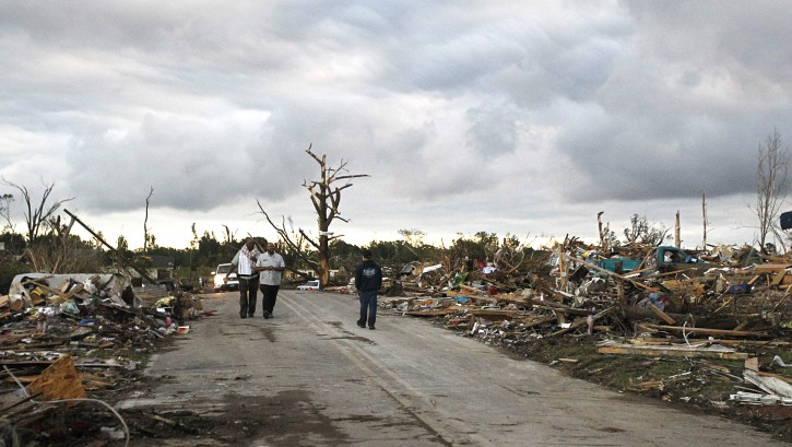 Residents search through what is left of their homes after a tornado hit Pleasant Grove just west of downtown Birmingham a day earlier, on Thursday, April 28, 2011, in Birmingham, Ala. (AP Photo/Butch Dill)
