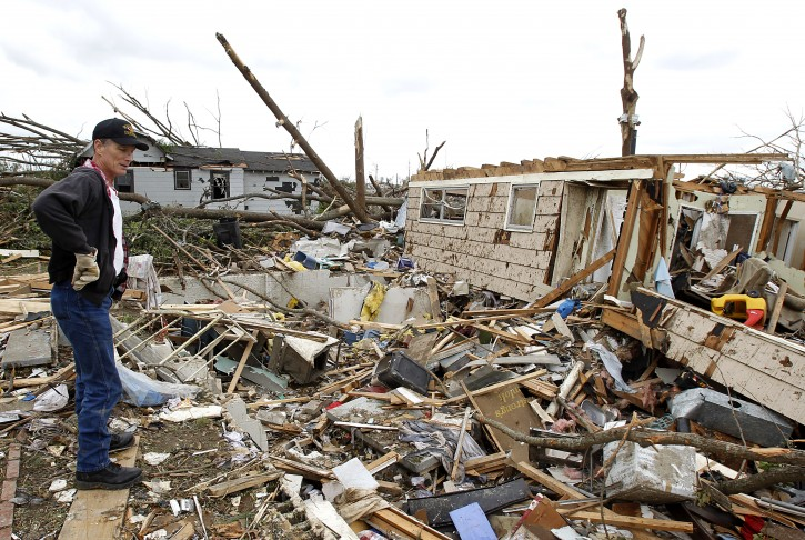 Garry Ellard searches for friends Thursday, April 28, 2011, in Birmingham, Ala., after a tornado hit Pleasant Grove, just west of downtown Birmingham, a day earlier.  (AP Photo/Butch Dill)