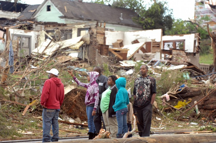 Residents survey storm damage in Pratt City, Alabama, USA, 28 April 2011. Severe weather and more than 100 tornados destroyed towns and killed more than 200 people across the Southern US on 27 April 2011.  EPA/CHRISTINE PRICHARD