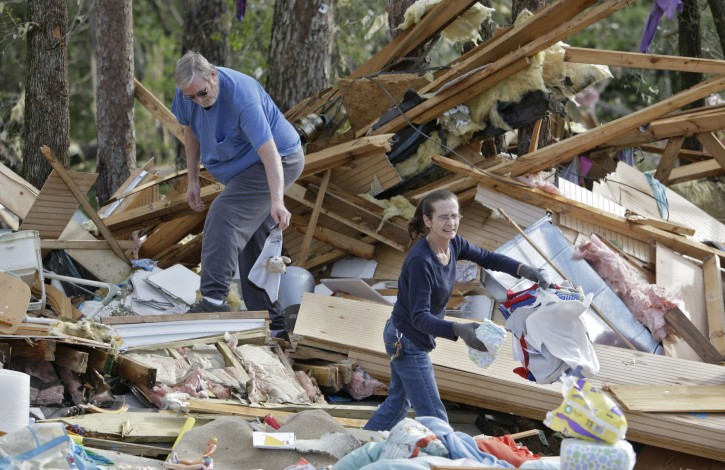 John Franklin, Jr, and his wife Kathy, help recover belongings from their son's home, in Bartow County, Ga. on Thursday, April 28, 2011. Dozens of tornadoes ripped through the South, flattening homes and businesses and killing at least 215 people in six states in the deadliest outbreak in nearly 40 years. (AP Photo/Atlanta Journal & Constitution, Bob Andres)