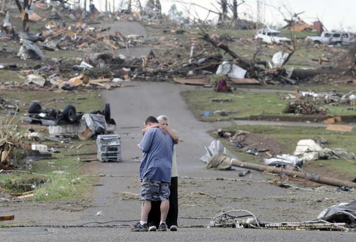 Michael Dunn is hugged by his mother Patricia Dunn as they stand in the road that lead to his house which was completely destroyed after a tornado touched down, Wednesday, April 27, 2011 in Concord, Ala. (AP Photo/Birmingham News, Jeff Roberts) MAGS OUT; NO SALES