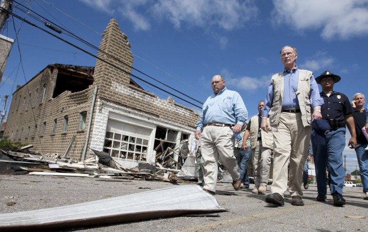 Alabama Gov. Robert Bentley, second from right, tours storm damage in Cullman, Ala., Thursday, April 28, 2011. (AP Photo/Dave Martin)