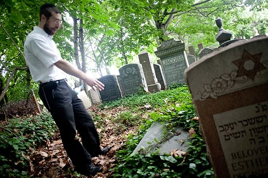 Greer points out a fallen stone. Photo: THOMAS MACMILLAN