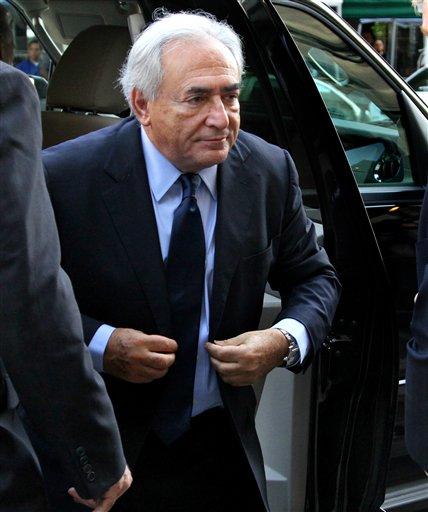 FILE - Former International Monetary Fund leader Dominique Strauss-Kahn walks towards the Manhattan Criminal Courts building Monday, June 6, 2011 in New York.  (AP Photo/Craig Ruttle)