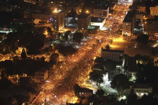 FILE - Thousands of Israelis march during a protest against the rising cost of living in Israel, in central Tel Aviv, Israel, Saturday, Aug. 6, 2011. AP