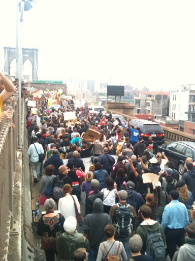 Police arrest demonstrators affiliated with the Occupy Wall Street movement after they attempted to cross the Brooklyn Bridge on the motorway, Saturday, Oct. 1, 2011 in New York. The highway is not intended for pedestrians, the marchers attempted to cross the bridge on the highway and were stopped on the middle of the bridge by police. (AP Photo/The Daily News, Anjali Mullany)  NYC LOCALS OUT