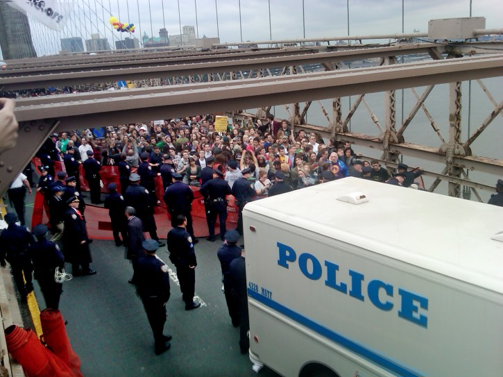 Police arrest demonstrators affiliated with the Occupy Wall Street movement after they attempted to cross the Brooklyn Bridge on the motorway, Saturday, Oct. 1, 2011 in New York. The highway is not intended for pedestrians, the marchers attempted to cross the bridge on the highway and were stopped on the middle of the bridge by police. (AP Photo/NBC, Andres Gutierrez)