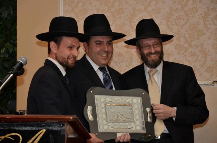 (L-R) Rabbi Frankel ,Assistant Director Mr Tuvia Grama ,Shocen Tov award Rabbi Gluck ,Director