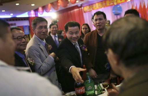 FILE -- John Liu, center, the New York City comptroller, during a party at the JingFong Restaurant in New York, Sept. 21, 2011. Canvassing of nearly 100 homes and workplaces of donors listed on Liu's campaign finance reports raises questions about the source and legitimacy of some donations. (Michael Appleton/The New York Times)