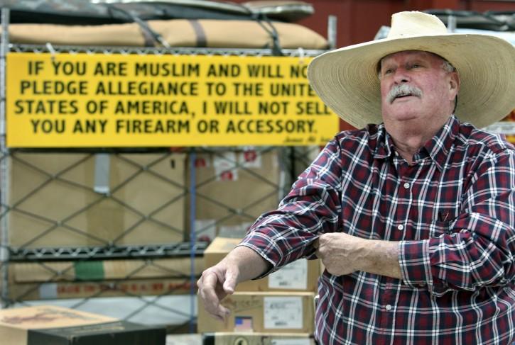 In this Oct. 28, 2011, photo, Crockett Keller prepares his merchandise at a gun show at the fairgrounds in Fredericksburg, Texas. (AP Photo/The San Antonio Express-News, Tom Reel)