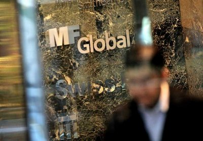 A view of a sign for the financial firm MF Global at one of the company's offices in New York, New York, USA, on 01 November 2011. MF Global Holdings Ltd, a broker-dealer firm, and its finance unit, MF Global Finance USA, on 31 October filed for reorganization under US bankruptcy law after losing its bets on European sovereign debt. The MF Global Holdings bankruptcy is the first large victim on Wall Street of the roiling euro debt crisis. In Europe earlier in October, the  Belgian-Franco-Luxembourg bank Dexia sought rescue by the Belgian government, pending final clearance from European Union antitrust regulators.  EPA/JUSTIN LANE