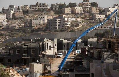 Construction work underway in a new neighborhood in the sprawling East Jerusalem neighborhood of Pizgat Zeev, which many consider a Jewish settlement, north of Jerusalem, 08 January 2012.  EPA