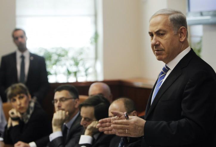 Israel's Prime Minister Benjamin Netanyahu, right, speaks during the weekly cabinet meeting in Jerusalem, Sunday, Jan. 1, 2012. (AP Photo/Ronen Zvulun, Pool)