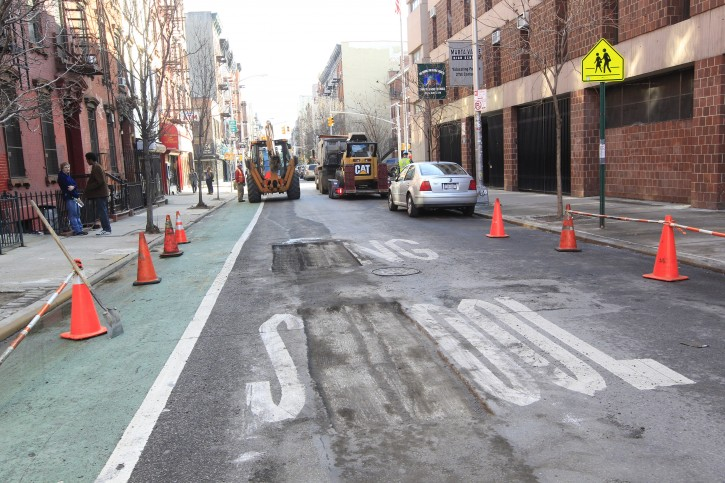 A misspelled school crossing sign is torn out of the pavement, Tuesday, Jan. 24 2012 on the Lower East Side neighborhood of New York. (AP Photo/Mary Altaffer)