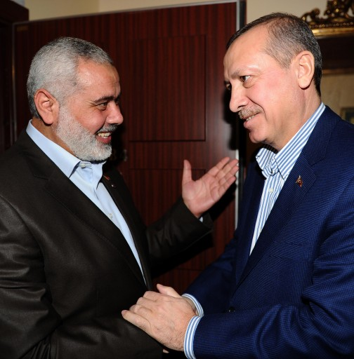 A handout picture provided by Prime Minister press office shows Hamas leader Ismail Haniyeh (L) and Turkish Prime Minister Recep Tayyip Erdogan shaking hands before their meeting at Erdogan's residence in Istanbul, Turkey 01 January 2012. According to media sources, Haniyeh started on 25 December 2011 a tour of several Muslim countries, his first since his militant Islamist movement seized control of the coastal enclave in June 2007. Haniyeh will visit Egypt, Sudan, Tunisia, Bahrain, and Turkey, his aide Yousef Rizqah said in a statement. The reported aim is to garner support for the Palestinians and for Gaza Strip.