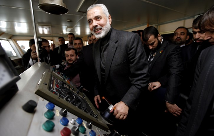 Hamas leader Ismail Haniyeh (L) poses at wheelhouse of the cruise liner Mavi Marmara during his visit in Istanbul, Turkey 02 January 2012. According to media sources, Haniyeh started on 25 December 2011 a tour of several Muslim countries, his first since his militant Islamist movement seized control of the coastal enclave in June 2007. Haniyeh will visit Egypt, Sudan, Tunisia, Bahrain, and Turkey, his aide Yousef Rizqah said in a statement. The reported aim is to garner support for the Palestinians and for Gaza Strip.  EPA/TOLGA BOZOGLU