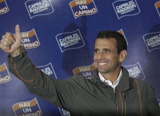Venezuelan presidential candidate Henrique Capriles flashes a thumbs-up before the start of a news conference in Caracas, Venezuela, Monday Feb. 13, 2012. Capriles who won Venezuela's first-ever opposition presidential primary Sunday,  as President Hugo Chavez seeks re-election. (AP Photo/Ariana Cubillos)