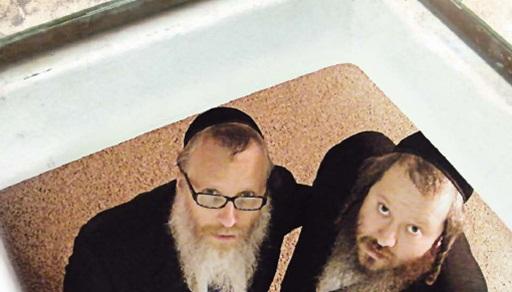 Rav Yechiel (L) and Rav Yitzchok Meyer Landau return to the bunker of salvation