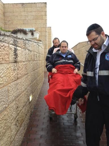 Founder of United Hatzalh Eli Beer taken away by Volunteers. Beer was injured while responding to an emergency call.
