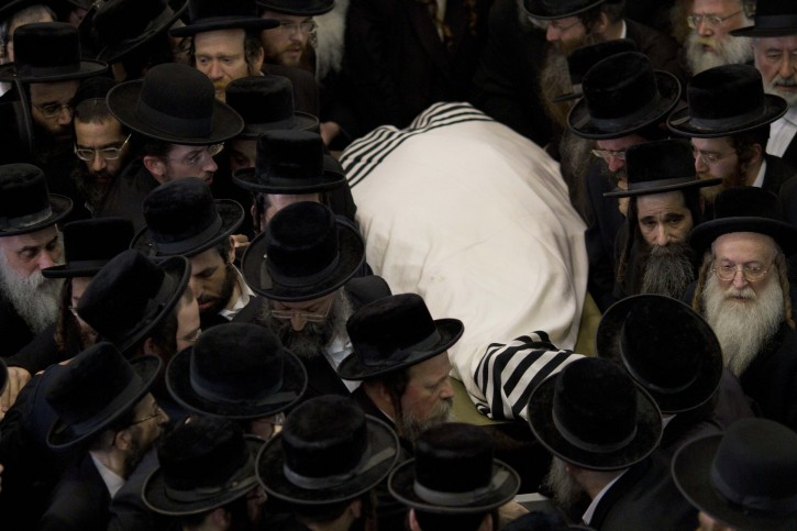 Ultra Orthodox carry the body of Rabbi Moshe Yehoshua Hager, leader of the Hassidic sect Vizhnitz in Israel, from the Vizhnitz Synagogue during his funeral procession in Bnei Brak , Ultra Orthodox Jewish town near Tel Aviv, Israel, Wednesday, March 14, 2012. Rabbi Moshe Yehoshua Hager was 95. (AP Photo/Ariel Schalit)